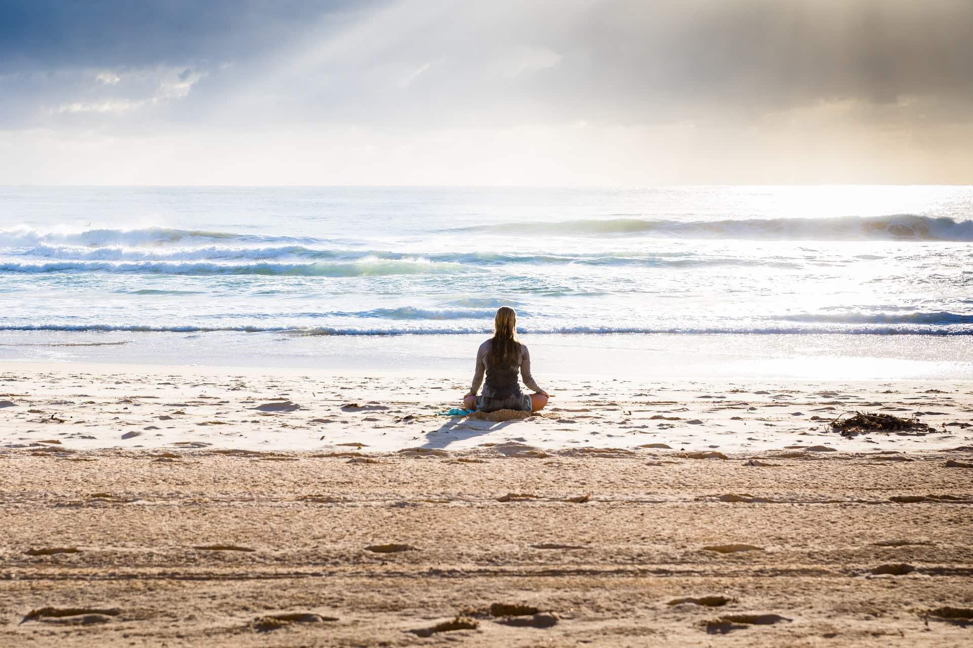meditation girl on the beach