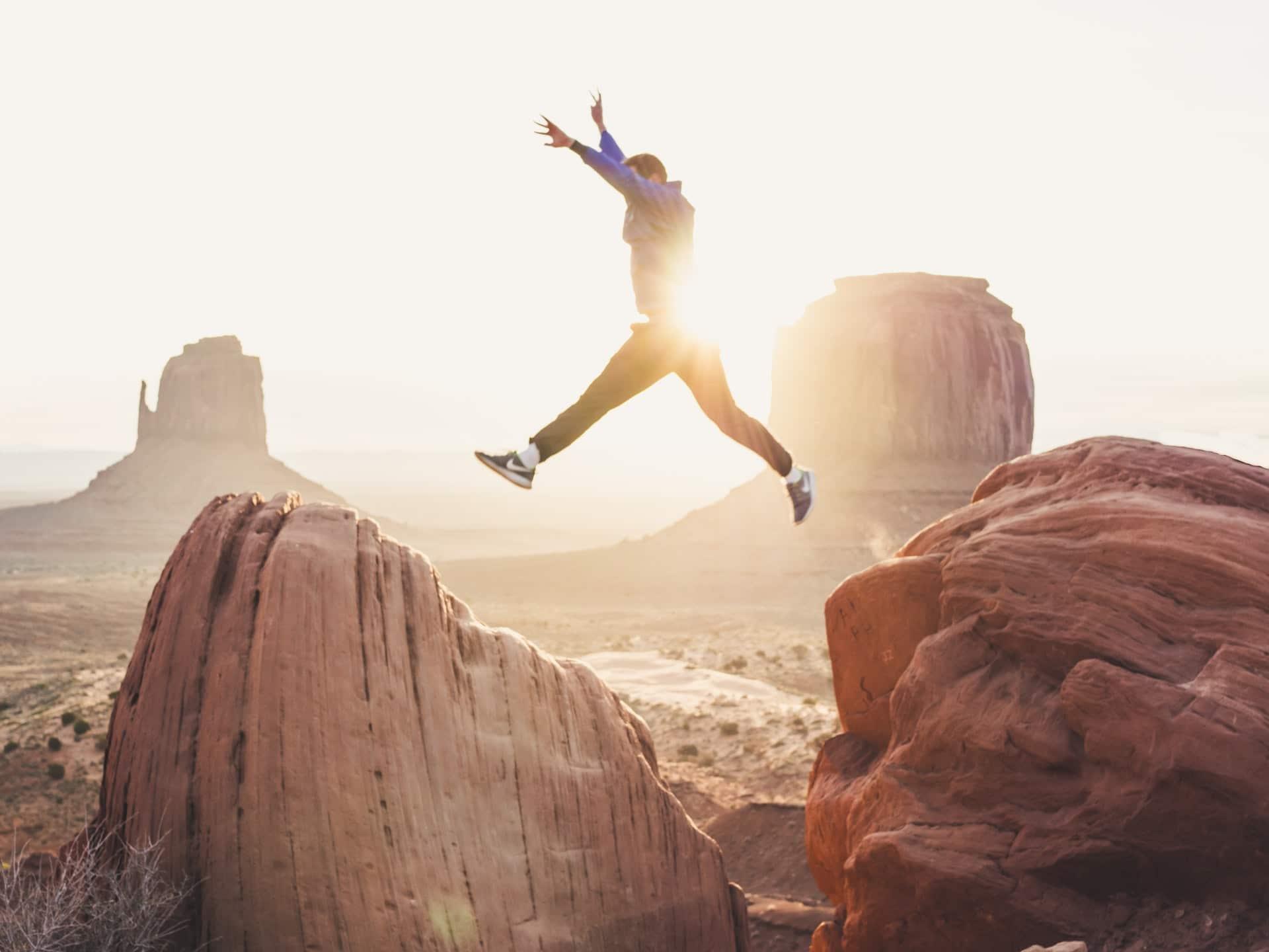 man jumping showing success